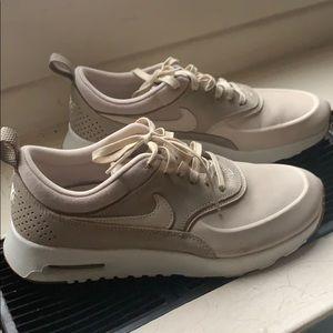 Light cream/tan Nikes